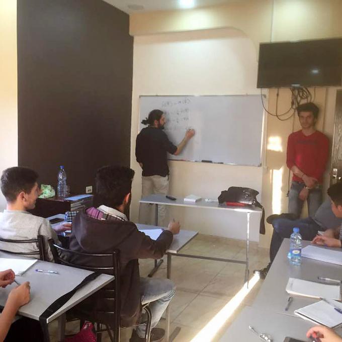 Ammar doing mathematical derivations